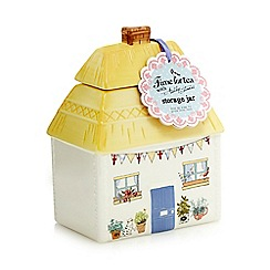 At home with Ashley Thomas - Cream house storage jar with biscuits