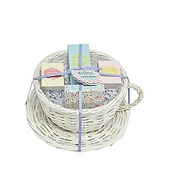 At home with Ashley Thomas - White teacup wicker planter with tea and biscuits