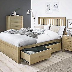 Debenhams - Oak 'Turin' bed frame with 4 drawers and slatted headboard