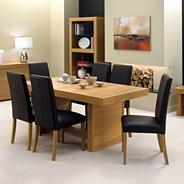 Oak 'Alpha' medium table and four upholstered chairs