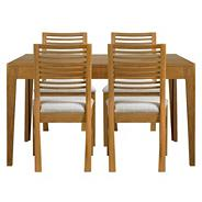 Oak 'Nord' extending table with four or six dining chairs