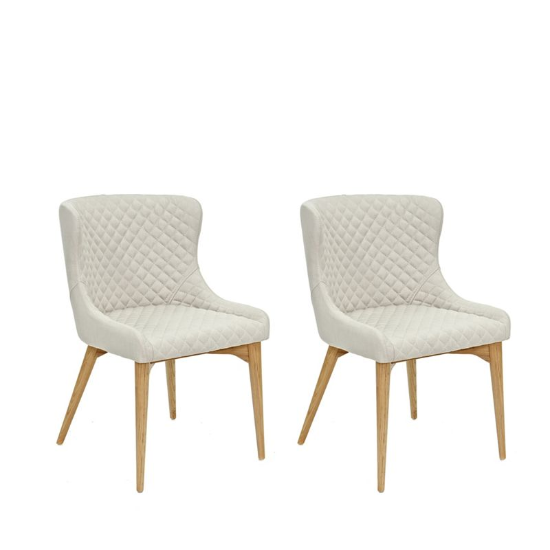 Willis & Gambier Pair of beige 'Angelo' quilted upholstered dining chairs with oak legs