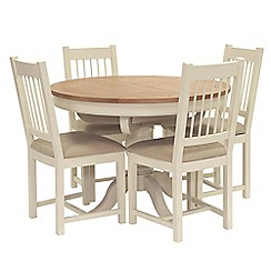 Willis & Gambier - Oak top 'Newquay' round extending dining table and 4 spindle back dining chairs with cream seats