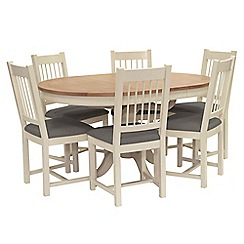 Willis & Gambier - Oak top 'Newquay' round extending dining table and 6 spindle back dining chairs with grey seats