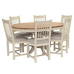 Willis & Gambier - Oak top 'Newquay' round extending dining table and 6 spindle back dining chairs with light grey seat