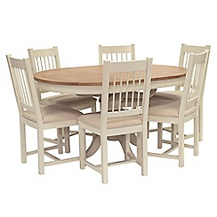 Willis & Gambier - Oak top 'Newquay' round extending dining table and 6 spindle back dining chairs with beige seats