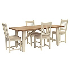 Willis & Gambier - Oak top 'Newquay' trestle dining table and 4 spindle back dining chairs with beige seats