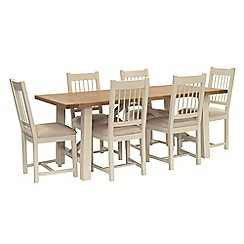 Willis & Gambier - Oak top 'Newquay' trestle dining table and 6 spindle back dining chairs with beige seats