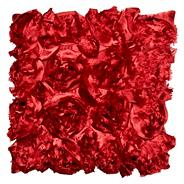 Red appliqued blossom cushion