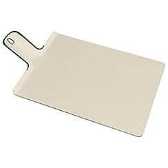 Joseph Joseph - Chop2Pot Plus small folding chopping board in putty