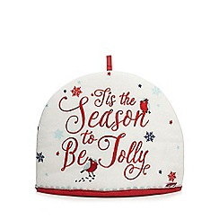At home with Ashley Thomas - Cream 'Tis the season to be jolly' tea cosy