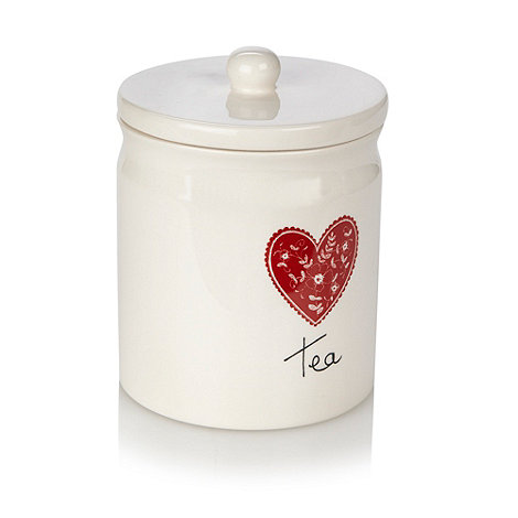 At home with Ashley Thomas - Cream ceramic heart printed tea jar