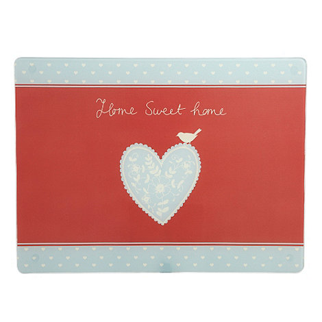 At home with Ashley Thomas - Glass floral heart chopping board