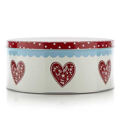 At home with Ashley Thomas - Metal red heart cake tin