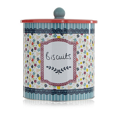 At home with Ashley Thomas - Blue floral biscuit tin