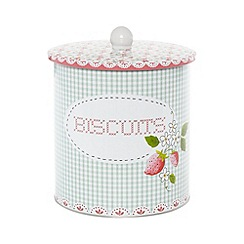At home with Ashley Thomas - Green gingham floral biscuit tin