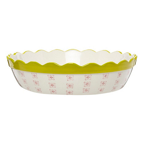 At home with Ashley Thomas - Designer white ceramic floral scalloped pie dish