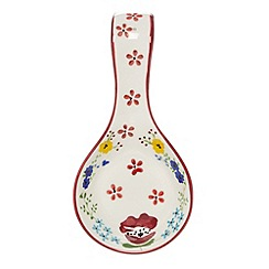 At home with Ashley Thomas - Designer cream ceramic floral spoon rest