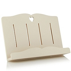 At home with Ashley Thomas - Cream wooden heart cut out book stand