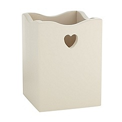 At home with Ashley Thomas - Cream wooden heart cutout utensil pot