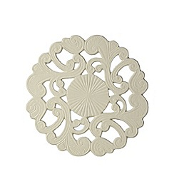 At home with Ashley Thomas - Cream metal antique trivet