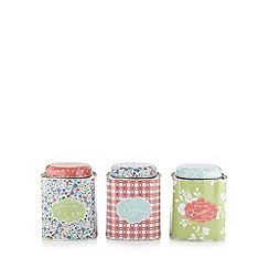 At home with Ashley Thomas - Set of three red floral storage tins