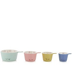 At home with Ashley Thomas - Set of four pale green stoneware measuring cups