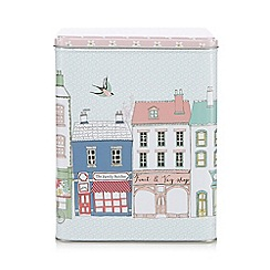 At home with Ashley Thomas - Metal shop print biscuit tin