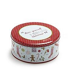 At home with Ashley Thomas - Christmas cake tin