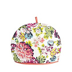 At home with Ashley Thomas - White floral tea cosy