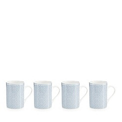At home with Ashley Thomas - Set of four spotted print porcelain mugs