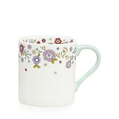 At home with Ashley Thomas - White porcelain floral print mug
