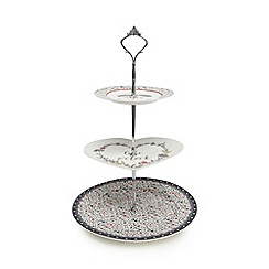 At home with Ashley Thomas - White 'cake o' clock' print three tiered cake stand in a gift box
