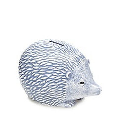 At home with Ashley Thomas - Blue porcelain hedgehog shaped money box