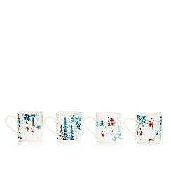 At home with Ashley Thomas - Pack of 4 white Christmas stacking mugs
