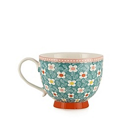 At home with Ashley Thomas - Stoneware green meadow floral mug