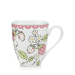 At home with Ashley Thomas - Light blue porcelain strawberry mug