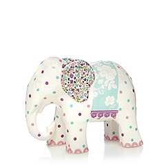 At home with Ashley Thomas - White floral spotted porcelain elephant money box
