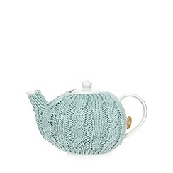 At home with Ashley Thomas - Porcelain knitted cosy teapot
