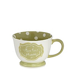 At home with Ashley Thomas - Green 'More Tea Please' large polka dot mug