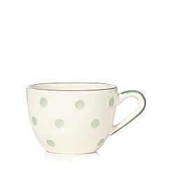 At home with Ashley Thomas - Light green spotted earthenware tea cup