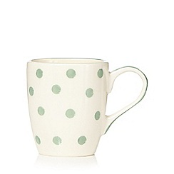 At home with Ashley Thomas - Light green spotted earthenware mug
