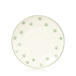 At home with Ashley Thomas - Light green spotted earthenware tea saucer