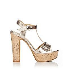 Wallis - Metallic laser cut block heel platform