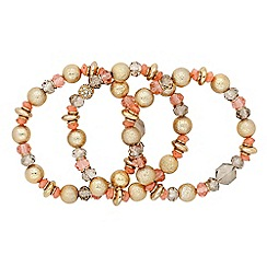 The Collection - Set of three mixed bead coral stretch bracelets