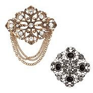 Set of two statement crystal brooches