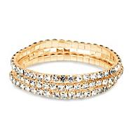 Set of three mini diamante crystal gold stretch bracelets