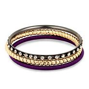 Set of three purple patterned bangles