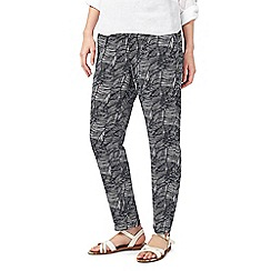 Dash - Latin palm print trousers