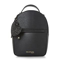 Head Over Heels by Dune - Black 'Hailie' mini backpack with glitter heart bag charm